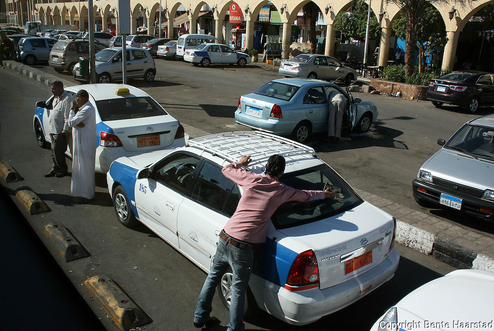 Taxis are everywere in the tourist cities and they are cheap in Egypt. Sharm Old Market.