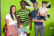 Match ball sponsor with man of the match Forest Green Rovers Udoka Godwin-Malife(22) during the EFL Sky Bet League 2 match between Forest Green Rovers and Grimsby Town FC at the New Lawn, Forest Green, United Kingdom on 17 August 2019.