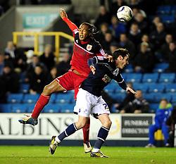 Bristol City's Neil Danns battles for the ball in the air with Millwall's Alan Dunne - Photo mandatory by-line: Dougie Allward/JMP - Tel: Mobile: 07966 386802 01/01/2013 - SPORT - FOOTBALL - The Den - London -  Millwall v Bristol City - Championship.