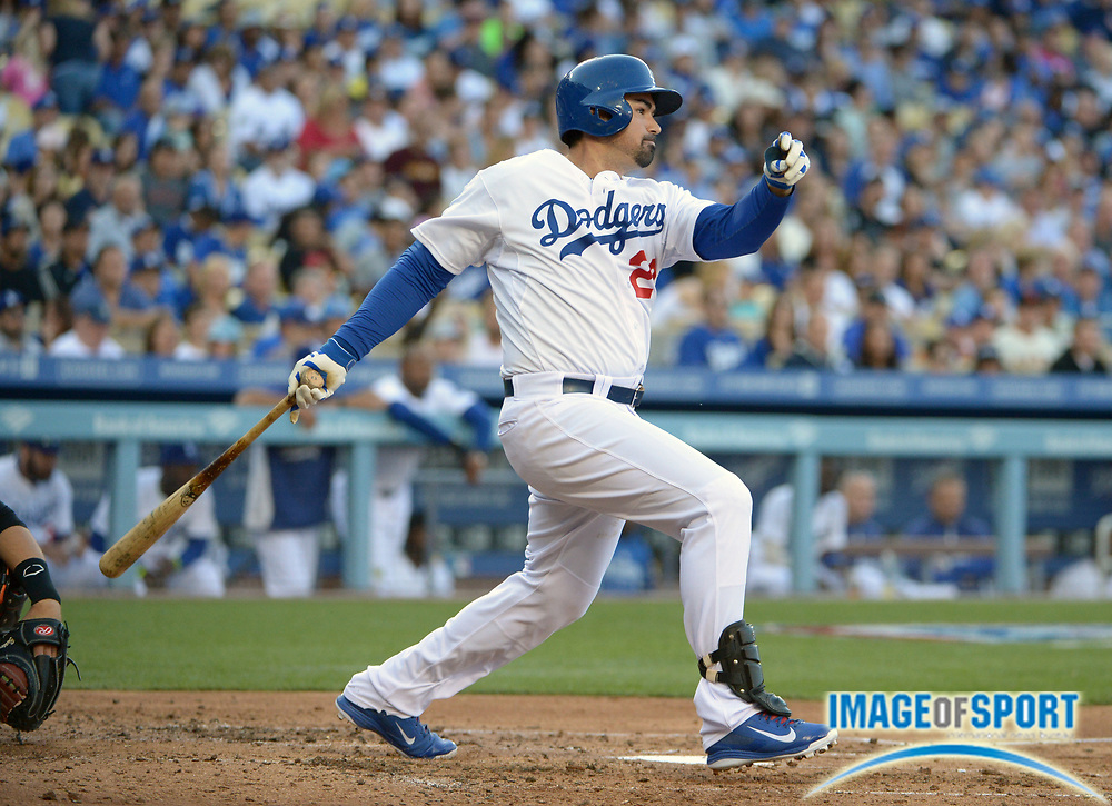 Apr 6, 2014; Los Angeles, CA, USA; Los Angeles Dodgers first baseman Adrian Gonzalez (23) follows through on a double in the fourth inning against the San Francisco Giants at Dodger Stadium.