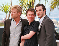 Jeremie Renier,  Bertrand Bonello and Gaspard Ulliel at the photo call for the film Saint Laurent at the 67th Cannes Film Festival, Saturday 17th May 2014, Cannes, France.