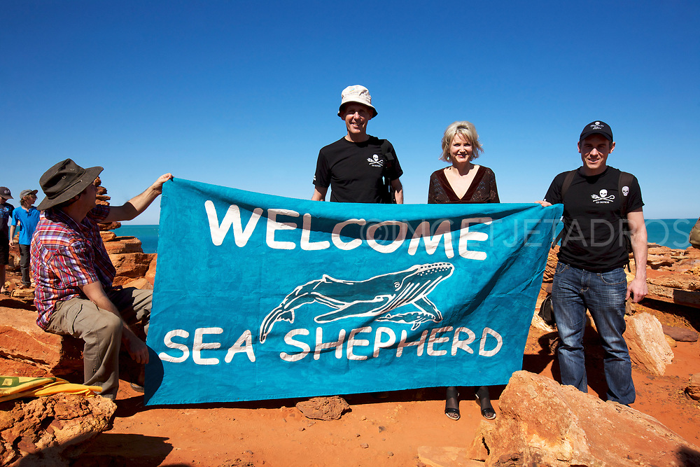 """Martin Pritchard, Director of Environs Kimberley holding a banner,""""Welcome Sea Shepherd"""", with former Green Leader Bob Brown and Melissa Parke, MP Federal Member for Fremantle and Jeff Hansen, Australian Director of the Sea Shepherd."""
