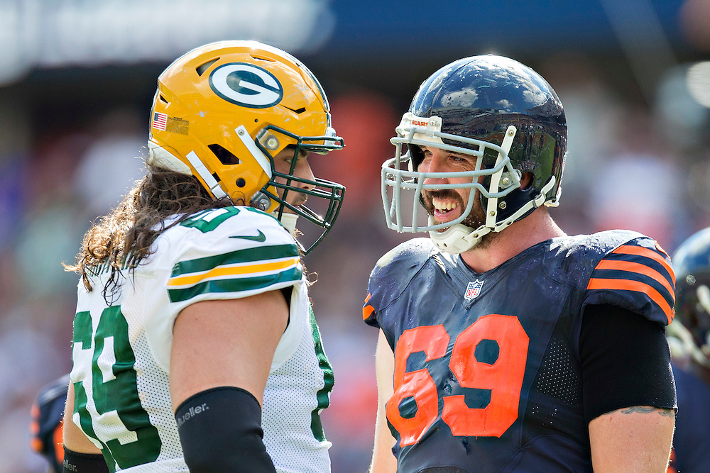 CHICAGO, IL - SEPTEMBER 13:  Jared Allen #69 of the Chicago Bears talks with David Bakhtiari #69 of the Green Bay Packers during a time out at Soldier Field on September 13, 2015 in Chicago, Illinois.  The Packers defeated the Bears 31-23.  (Photo by Wesley Hitt/Getty Images) *** Local Caption *** Jared Allen; David Bakhtiari