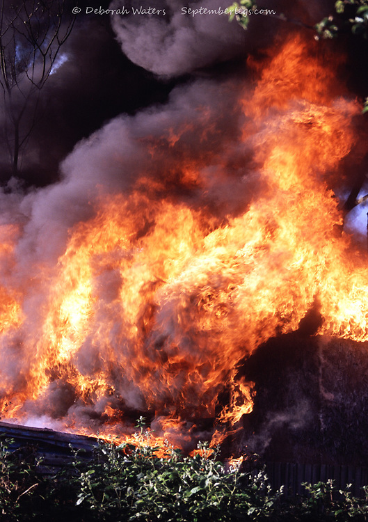 Close up on the blazing inferno of a suburban garden shed on fire, Oxford, UK