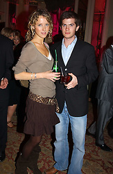 KATE MELHUISH and JACK FREUD at a party to celebrate Pamela Anderson's new role as spokesperson and newest face of the MAC Aids Fund's Viva Glam V Campaign held at Home House, Portman Square, London on 21st April 2005.<br />