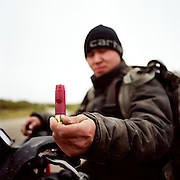 """My favorite thing to do is go out hunting—everyday, pretty much. When the freezer is almost empty, we just go out everyday. There is geese in the fall time and moose and caribou—we have got options here.""—Logan Gusty, a Yup'ik hunter in Bethel, Alaska holding his homemade duck call."