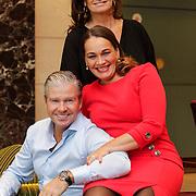 NLD/Amsterdam/20121016 - Dries Roelvink met zijn huidige partner en ex, die samen weer door een deur kunnen