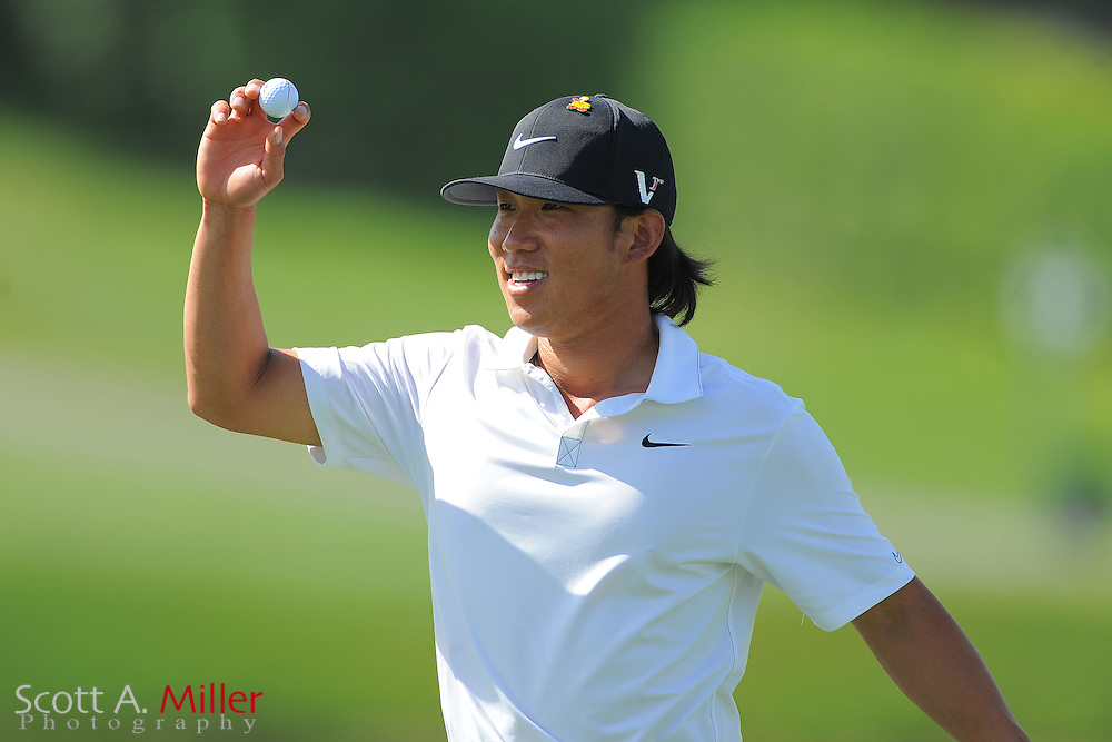 Anthony Kim waves to the crowd after a hole-in-one on the 17th hole during the first round of the Arnold Palmer Invitational at the Bay Hill Club and Lodge on March 22, 2012 in Orlando, Fla. ..©2012 Scott A. Miller.