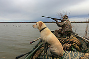 Hunting from a row boat during a Manitoba waterfowl hunt.
