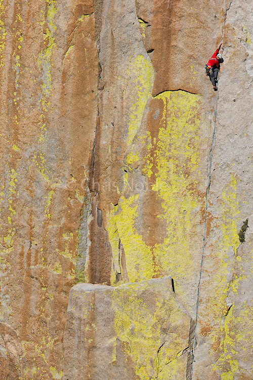 "Conrad Anker  climbing ""Thin Ice"" (10b) on ""The Sorcerer,"" in The Needles of Southern California."