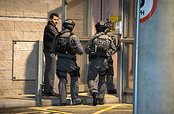 © Licensed to London News Pictures. 17/11/2015. London, UK. Armed police entering the stadium. Armed police officers watch over fans at Wembley Stadium ahead of a friendly game between England and France. The UK has been on a heightened security alert following multiple terrorist attacks in Paris last week in which over 120 people were killed. Photo credit: Ben Cawthra/LNP