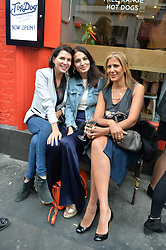 Left to right, SADIE FROST, YASMIN MILLS and AZZI GLASSER at a party to celebrate the launch of Top Dog at 48 Frith Street, Soho, London on 27th May 2015