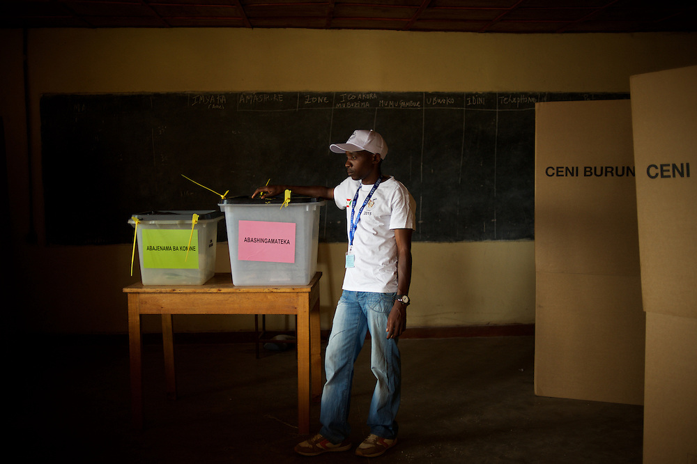 A staff member for the Burundian National Independent Electoral Commission minds a the ballot boxes at a polling station in Kinama neighbourhood in Bujumbura, to vote in the country's parliamentary elections, on June 29, 2015.