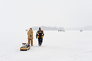 Walking across Lake of Bays to do some ice fishing<br />Near Baysville<br />Ontario<br />Canada