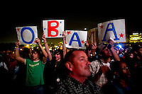Barack Obama supporters hold up signs as supporters take to Chicago's Grant Park for the election night results for the presidential race between Sen. Barak Obama (D-IL) and Sen. John McCain (R-AZ) Tuesday Nov. 4, 2008 Chicago IL.