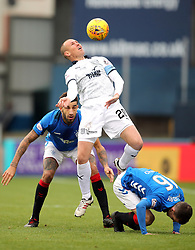 Dundee's Kenny Miller (centre) and Rangers' Andy Halliday battle for the ball during the Scottish Premiership match at Dens Park, Dundee.