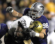 MANHATTAN, KS - OCTOBER 13:  Manhattan, KS -  Defenders Ian Campbell #98 of the Kansas State Wildcats tackles running back Brian Lockridge #20 of the Colorado Buffaloes for a loss in the third quarter, during a NCAA football game on October 13, 2007 at Bill Snyder Family Stadium in Manhattan, Kansas.  Kansas State won 47-20.  (Photo by Peter Aiken/Getty Images)