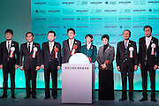 Japanese Prime Minister Shinzo Abe, fourth right, Olympic Minister Tamayo Marukawa, third right, Cabinet Office Vice Minister Toshiei Mizuochi, second right, and Tokyo Gov. Yuriko Koike, right, turn on the switch during a groundbreaking ceremony of new national stadium in Tokyo, Sunday, Dec. 11, 2016. Tokyo held the ceremony on Sunday for a $1.5 billion National Stadium to host the 2020 Olympic Games. 11/12/2016-Tokyo, JAPAN