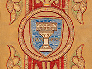 "Medallion with a baptismal font with 3 crosses inscribed ""Louis de Poissy"", from a Chasuble with orfroi embroidery in gold, 1910, from the Collegiale Notre-Dame de Poissy, a catholic parish church founded c. 1016 by Robert the Pious and rebuilt 1130-60 in late Romanesque and early Gothic styles, in Poissy, Yvelines, France. The Collegiate Church of Our Lady of Poissy was listed as a Historic Monument in 1840. Picture by Manuel Cohen"
