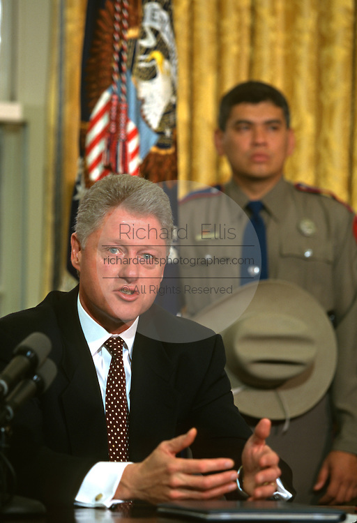 U.S. President Bill Clinton discusses gun control during his weekly address in the Oval Office of the White House March 5, 1997 in Washington, DC.