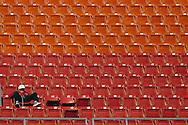 ATLANTA, GA-1989:  An Atlanta Falcons fan sits in the upper deck by himself at Atlanta Fulton County Stadium in Atlanta, Georgie.  (Photo by Ron Vesely)