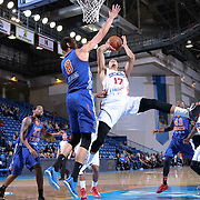 Delaware 87ers Guard Jared Cunningham (17) drives towards the basket as Westchester Knicks Center Ben Strong (8) defends in the first half of a NBA D-league regular season basketball game between the Delaware 87ers and the Westchester Knicks (New York Knicks) Wednesday, Feb. 17, 2015 at The Bob Carpenter Sports Convocation Center in Newark, DEL