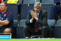 Photo: Paul Thomas.<br /> Manchester City v Arsenal. The Barclays Premiership. 26/08/2006.<br /> <br /> Arsene Wenger, Arsenal manager looks on not very happy.