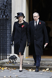 © Licensed to London News Pictures. 12/11/2017. London, UK. Prime Minister Theresa May and her husband Philip walk from Downing Street to attend the Remembrance Sunday Ceremony at the Cenotaph in Whitehall. Photo credit: Peter Macdiarmid/LNP