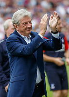 Football - 2018 / 2019 Premier League - Fulham vs. Crystal Palace<br /> <br /> Roy Hodgson, Manager of Crystal Palace, acknowledges the supporters of his previous club as he prepares to take his seat in the dugout at Craven Cottage<br /> <br /> COLORSPORT/DANIEL BEARHAM