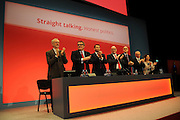Labour Party Annual Conference<br /> Brighton<br /> 27-30 September<br /> Opening of conference platform.<br /> L-R Jeremy Corbyn, newly elected leader of the labour party, his deputy Tom Watson and members of the CAC and NEC, acknowledge the applause from the assembled delegates at the opening session of the conference.