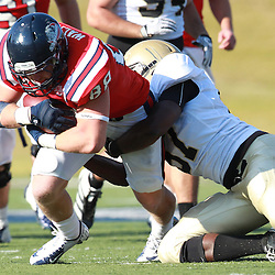 Samford tight end Zeke Walters  is hit by  Wofford Mike McCrimon in the first half at Seibert Stadium in Homewood, Ala., Saturday, Oct 13, 2012. Samford defeats Wofford 24-17 in Overtime. (Marvin Gentry)