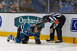 Mar 6, 2012; San Jose, CA, USA; San Jose Sharks center Joe Pavelski (8) is attended to by NHL referee Rob Martell (right) after falling into the boards during the first period against the Edmonton Oilers at HP Pavilion. Mandatory Credit: Jason O. Watson-US PRESSWIRE
