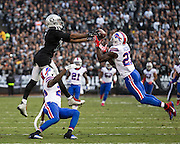 Oakland Raiders wide receiver Michael Crabtree (15) has a pass blocked by the Buffalo Bills defense at Oakland Coliseum in Oakland, Calif., on December 4, 2016. (Stan Olszewski/Special to S.F. Examiner)