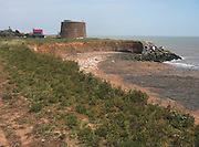 Rapid coastal erosion at East Lane, Bawdsey, Suffolk, England. Soft crag cliffs are easily eroded, dark underlying London clay is exposed.