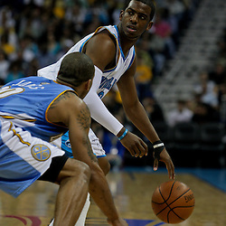 27 April 2009: New Orleans Hornets guard Chris Paul (3) is guarded by Denver Nuggets guard Dahntay Jones (30) during game four of the NBA Western Conference Quarterfinals playoffs between the New Orleans Hornets and the Denver Nuggets at the New Orleans Arena in New Orleans, Louisiana.