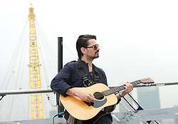 30 Seconds to Mars perform a unique one-off gig at the top of the O2 Arena roof, to promote their new album <br /> Love Lust Faith + Dreams, <br /> In the photo - Tomo Milicevic<br /> London, United Kingdom<br /> Tuesday, 18th June 2013<br /> Picture by Elliot Franks / i-Images