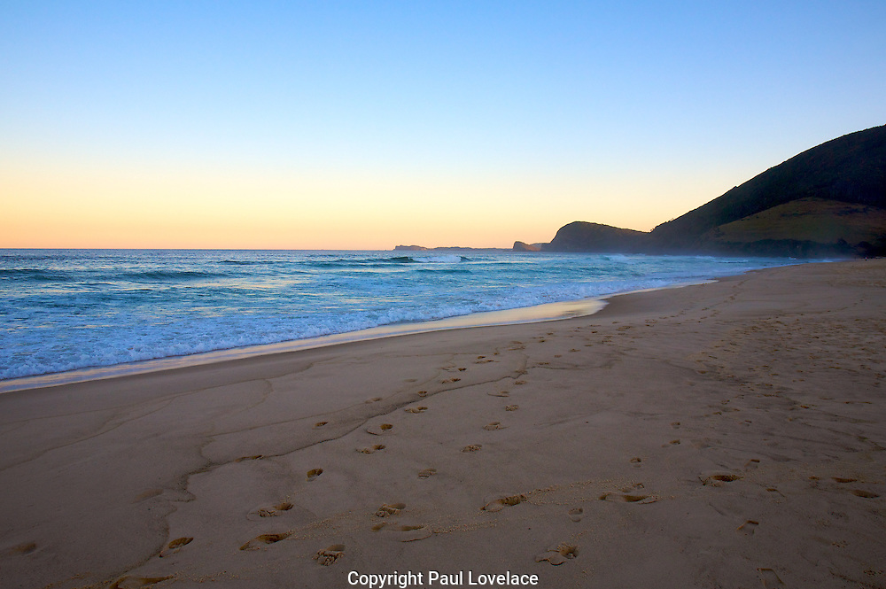 Sunset at Blueys Beach, NSW Australia.Bluey's Beach is 280km north of Sydney, on the mid-north coast of NSW. The beatiful area offers great fishing, bushwalks, and boating on the lake..Paul Lovelace Photography