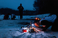 Rob Belley of Marshfield, Mass., tries to start a fire without matches, one of the challenges during the second day of the Peak Winter Death Race on February 1, 2014. (Valley News - Will Parson)