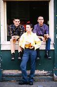 Band stood outside pub in Highgate holding pints, London, UK, 1980s.