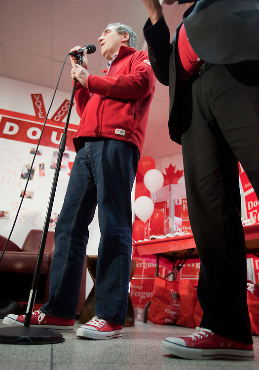 Liberal leader Michael Ignatieff talks to the media in some new red converse shoes which he has for the last days at the campaign at a campaign stop in London, Ontario, Friday April 29, 2011.<br /> REUTERS/Geoff Robins (CANADA)