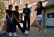 """08-19070      Chinese students, (from left) """"Popo"""" Huang, Cheng Li, Zhenwei Chen and Dongni Heng hangout outside their Scott Quad dorm room, on Wednesday, September 24."""