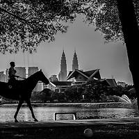Kuala Lumpur City Hall (DBKL) mounted horse unit conducts routine patrols at Titiwangsa Lake in Kuala Lumpur, Malaysia.