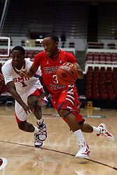 Nov 15, 2011; Stanford CA, USA;  Fresno State Bulldogs guard Kevin Olekaibe (3) dribbles past Southern Methodist Mustangs guard Ryan Manuel (1) during the first half of a preseason NIT game at Maples Pavilion.  Mandatory Credit: Jason O. Watson-US PRESSWIRE