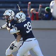 Jaeden Graham, Yale, collects his blocked punt to score a touchdown for Yale during the Yale Vs Princeton, Ivy League College Football match at Yale Bowl, New Haven, Connecticut, USA. 15th November 2014. Photo Tim Clayton
