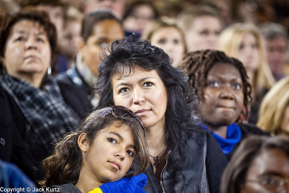 obamatucson 12 JANUARY 2011 - TUCSON, AZ: Donna Ramirez (CQ) RIGHT and her daughter Samantha Ramirez (CQ) listen to President Obama in the University of Arizona stadium Wednesday when it was used for overflow seating during the Together We Thrive Tucson & America event on University of Arizona campus. Tens of thousands of people filed into the stadium to hear President Obama speak. The service is for the victims of Saturday's mass shooting at a Safeway in Tucson.        ARIZONA REPUBLIC PHOTO BY JACK KURTZ..Gabrielle Giffords shooting, mass shooting,