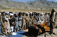 Afghanistan. With the mudjahidines in Paktia province in August 1979. prayer, islamic ceremony  for the burial of the moudjahidines killed in the fighting near Gardez . Paktia  Afghanistan / enterrement des moudjahidines   tues dans les combats de nuit pres de Gardez. priere  Paktia  Afghanistan