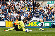 Simeon Jackson of Millwall (right) puts the ball past Lee Camp of Bournemouth only to see it go wide of the goal post during the Sky Bet Championship match at The Den, London<br /> Picture by David Horn/Focus Images Ltd +44 7545 970036<br /> 03/05/2014