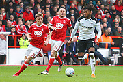 erby's Kasey Palmer takes on Nottingham Forest's Ben Osborn and Nottingham Forest's Lee Tomlin during the EFL Sky Bet Championship match between Nottingham Forest and Derby County at the City Ground, Nottingham, England on 11 March 2018. Picture by John Potts.