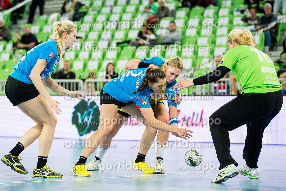Liliy Artsiukhovich #2 of Krim Mercator and Misa Marincek #16 of RK Krim Mercator vs Luisa Schulze of Leipzig during handball match between RK Krim Mercator (SLO) and HC Leipzig (GER) in 6th Round of Women's EHF Champions League 2014/15, on November 21, 2014 in Arena Stozice, Ljubljana, Slovenia. Photo by Vid Ponikvar / Sportida
