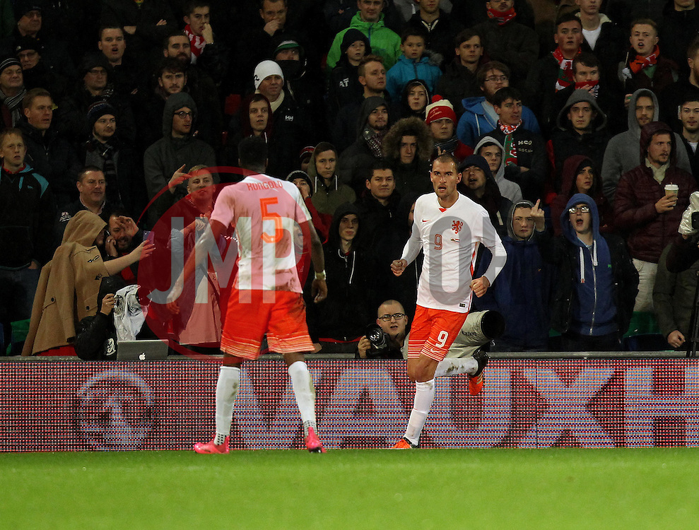 Bas Dost of The Netherlands celebrates with Terence Kongolo of The Netherlands after scoring - Mandatory byline: Robbie Stephenson/JMP - 07966 386802 - 13/11/2015 - FOOTBALL - Cardiff City Stadium - Cardiff, Wales - Wales v Netherlands - International Friendly